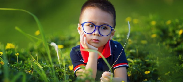 toddler thinking in a field