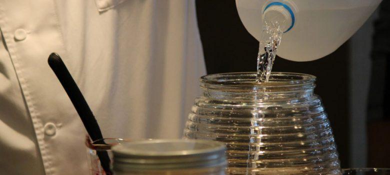 chef pouring water making kombucha